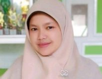 Ilham Mida, S.Pdi (Guru BK SMAN 5 Bukittinggi)